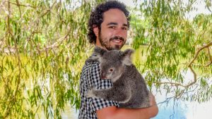 Hold Koala for a souvenir photo